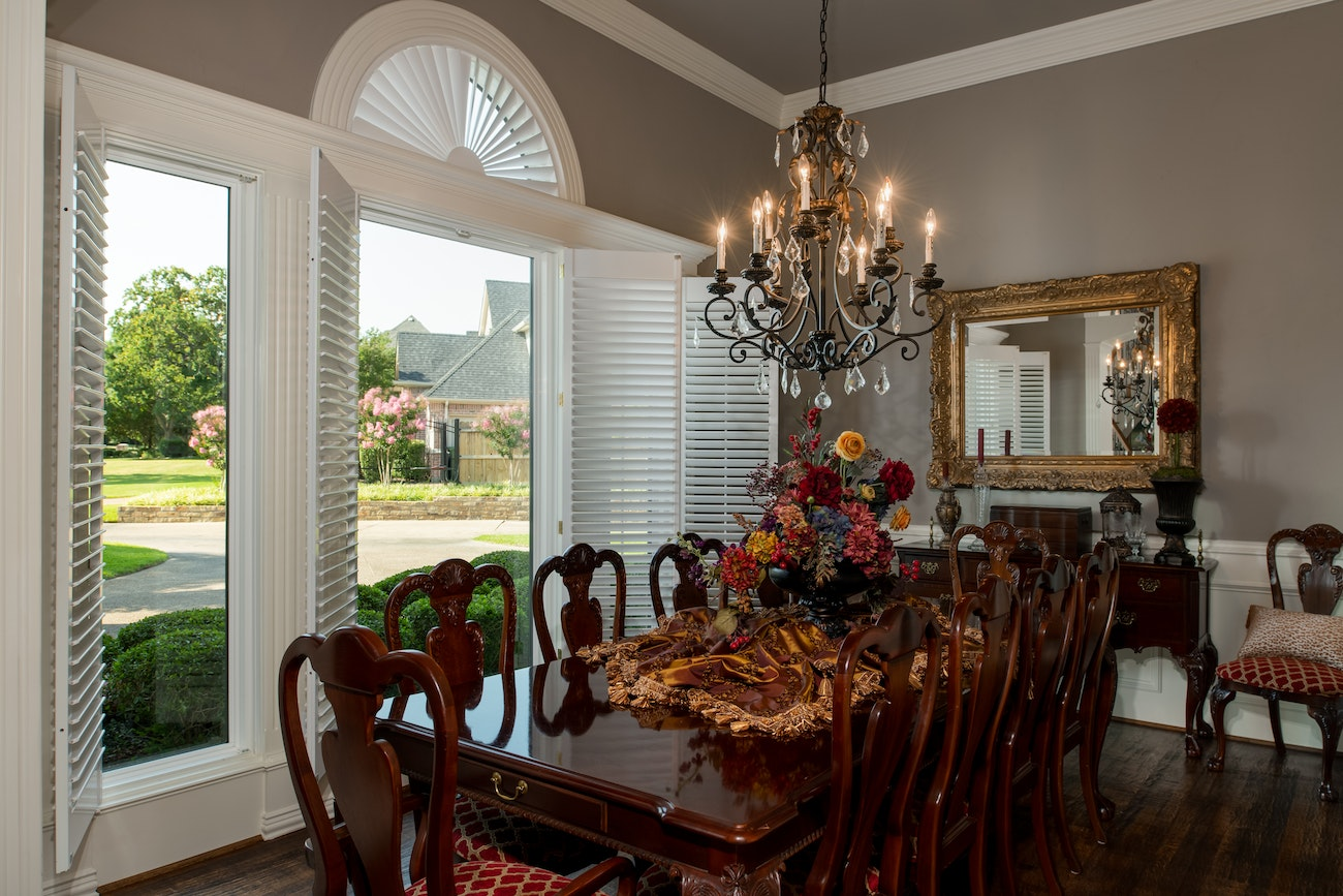 brennan-traditions-dining-room-area-with-white-shutters-on-window