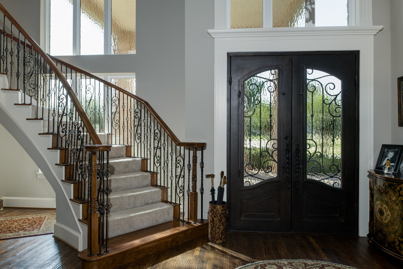 brennan-traditions-interior-view-of-stairwell-and-french-door-white-window-trim-2