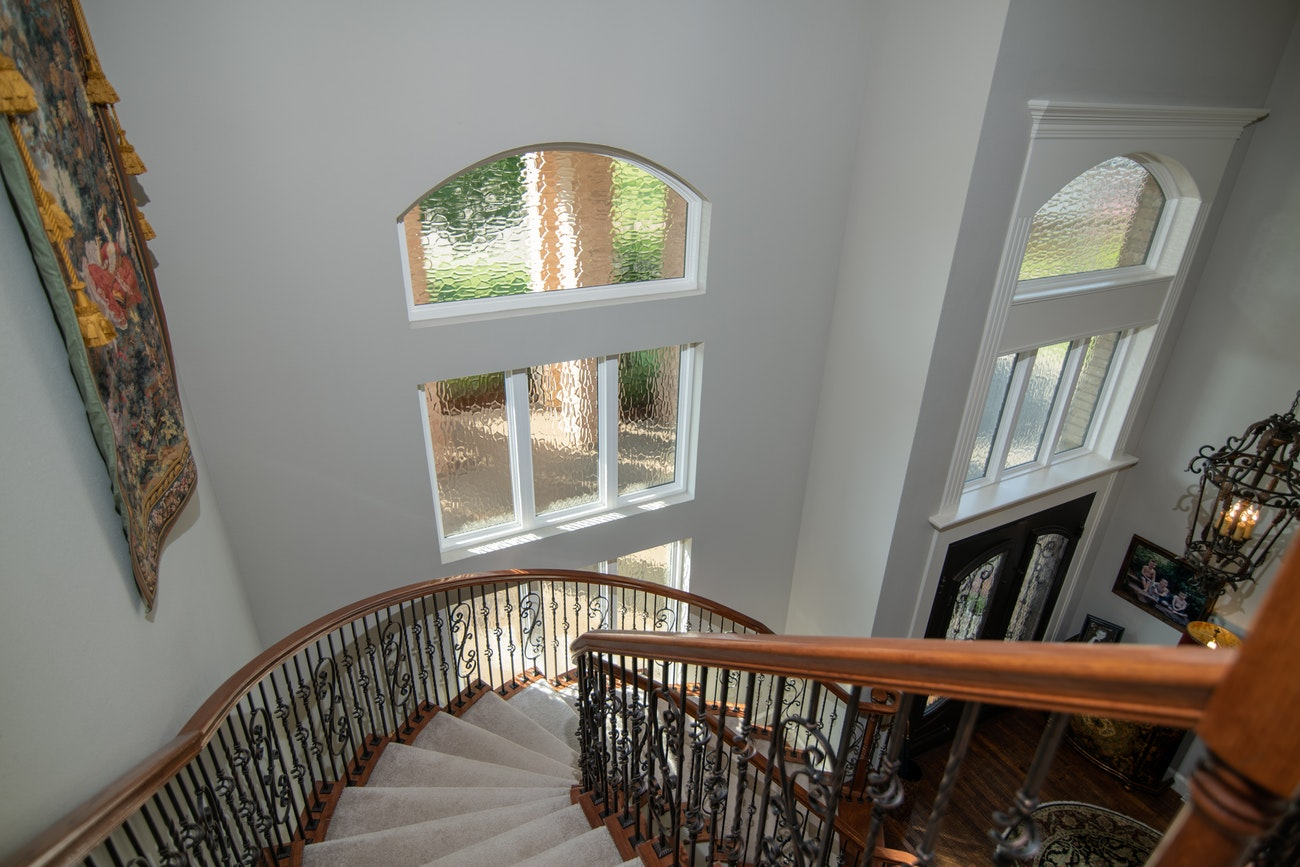 brennan-traditons-specialty-picture-windows-with-privacy-glass-stair-case-view