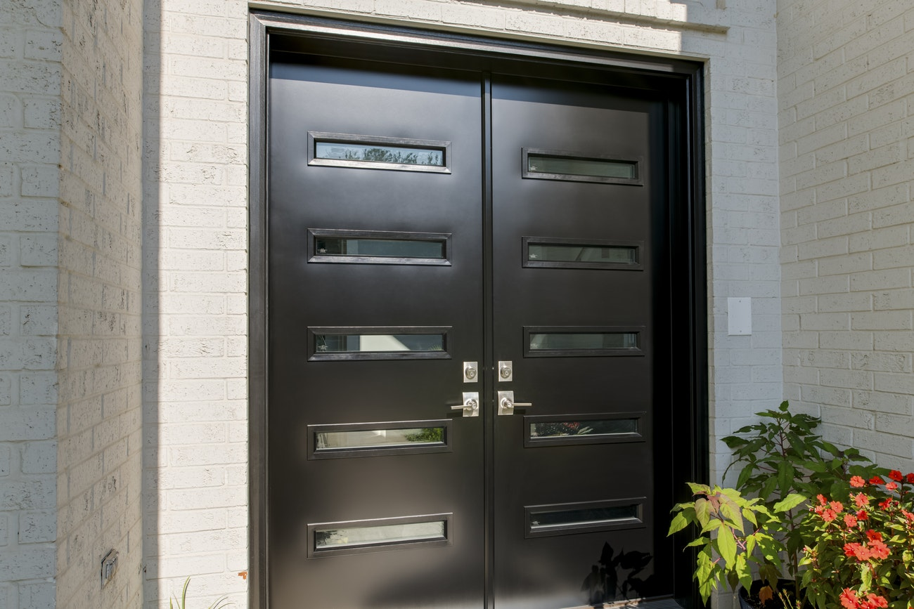 black-french-style-doors-with-glass-panels-close-up