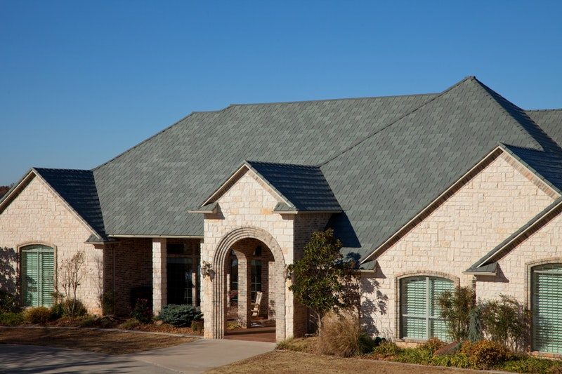 Davinci Roofscapes composite roof tiles in Bellaforte Slate Evergreen.
