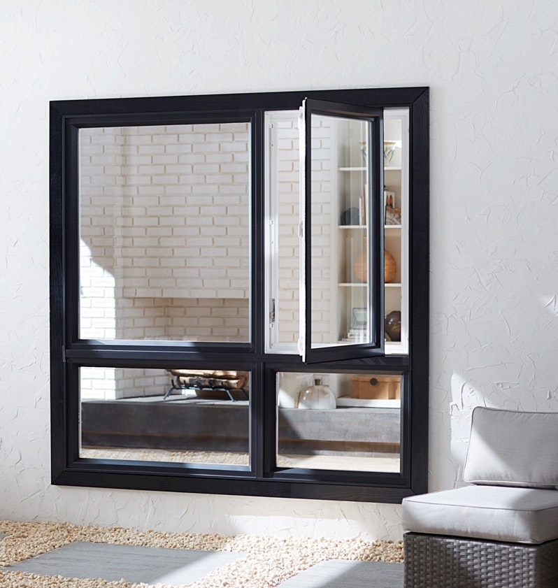 Exterior view of two Jeld-Wen Premium Vinyl Casement windows with black frames atop a set of black awning windows.