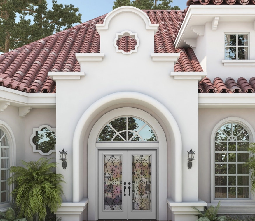Exterior view of white Jeld-Wen Premium Vinyl Half Round Specialty Windows and grids above ornate white double entry doors.