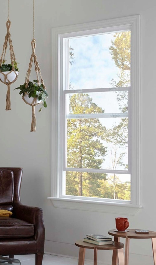 Interior view of Jeld Wen Premium Vinyl single hung window with lifted sash and two visible style cam locks.