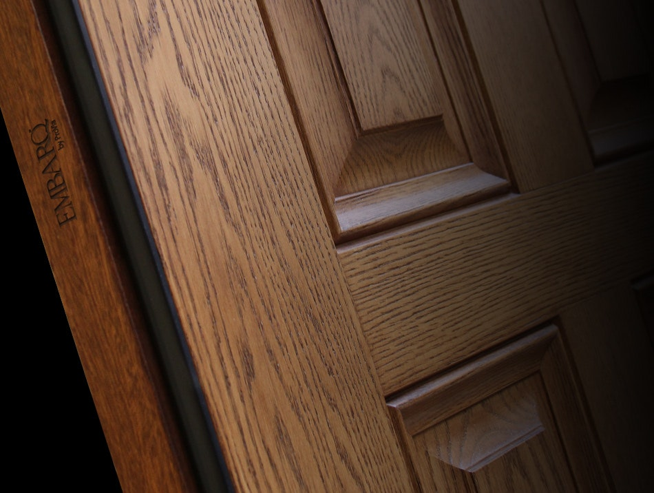 ProVia Embarq entry door closeup featuring the woodgrains of the exterior skin and the Embarq logo imprinted on the side of the door.