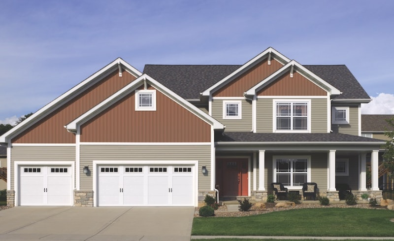 Two-story suburban house with vertical and lap siding