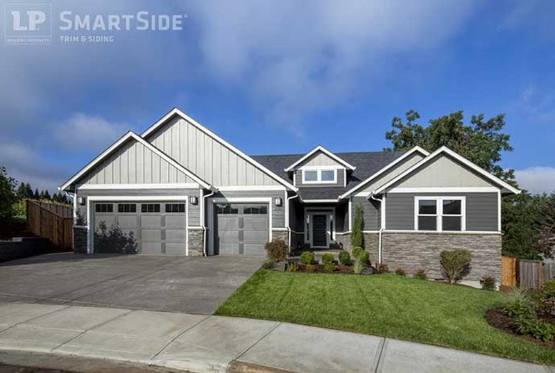 Suburban house with lap siding and board and batten.