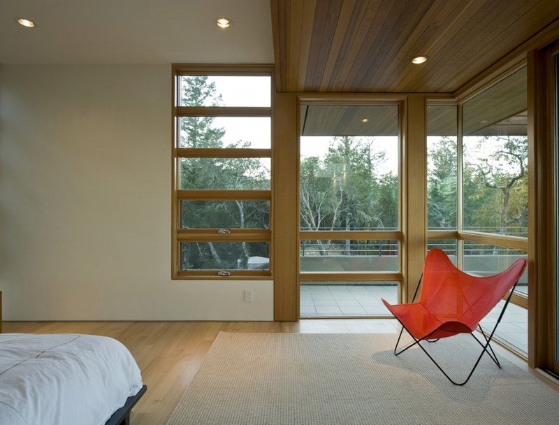 Large modern bedroom with several EpicVue fixed picture windows finished with a natural oak lacquer.