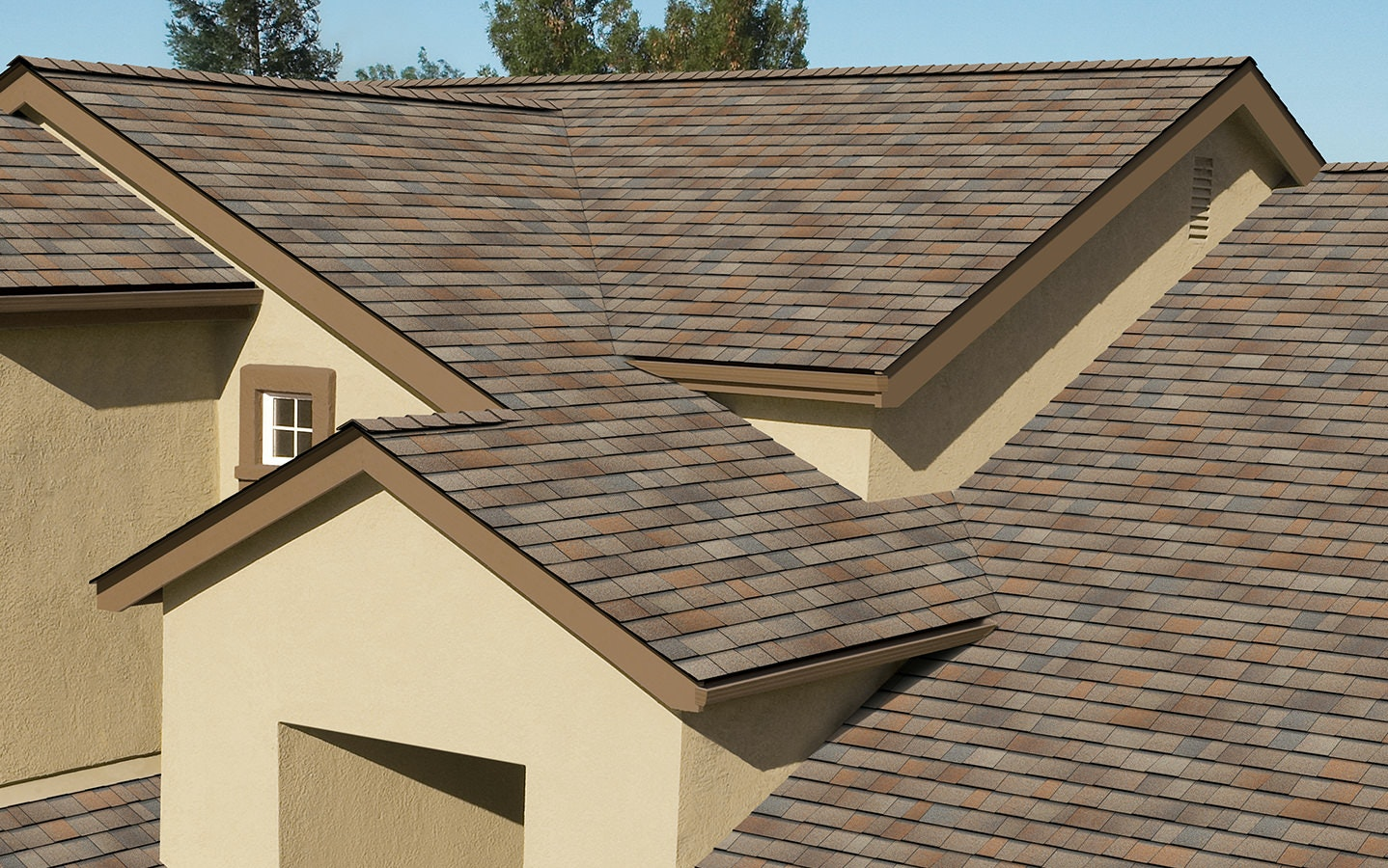Duration Premium Cool roof in sunrise on a sand colored stucco home.