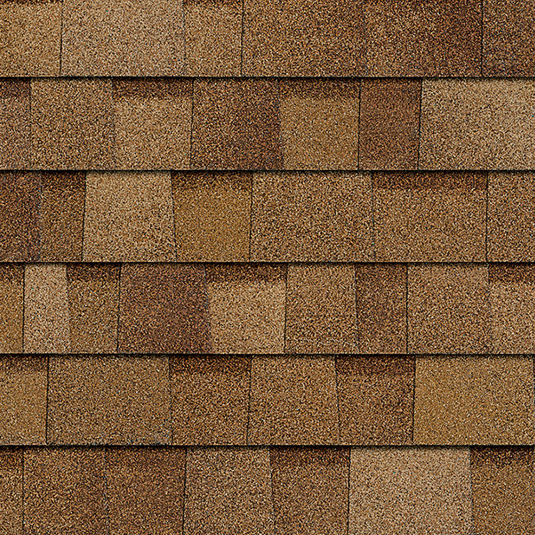 Sample of Desert Tan Owens Corning shingles.