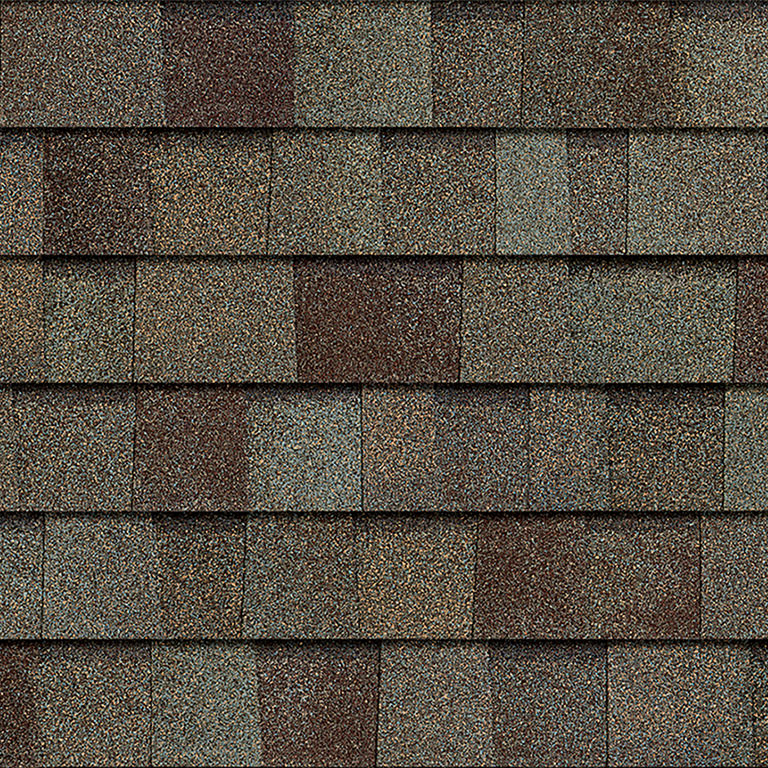 Sample of Driftwood Owens Corning shingles.